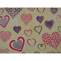 Papel de regalo corazones variados fondo amarillo 31cm