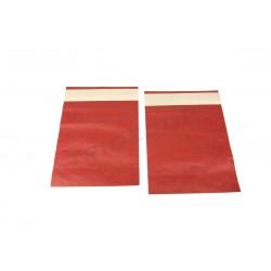 En el paper de color vermell fort 30x25cm 50 unitats